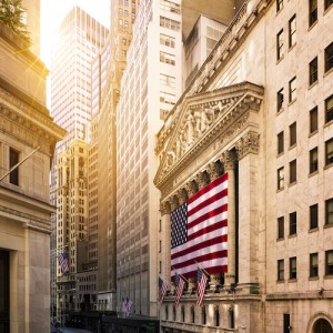 Famous Wall street and the building in New York, New York Stock Exchange with patriot flag; Shutterstock ID 415926982; user id: 14687045; user email: sweetuu@sweetuu.com; user_country: China; discount: 38%